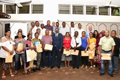 Title deeds presented to 27 ex-employees of former sugar estates Mon Loisir and Beau Champ