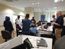 Stakeholders participate in a Whole of Island Disaster Impact National Emergency Operations Command exercise